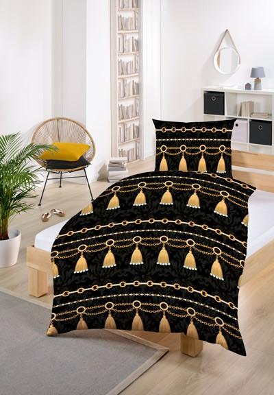 dunkle bettwäsche mit glockenmotiv auf einer weißen matratze im schlafzimmer auf einem Bett mit Holzgestell
